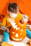 Boy and lighting Halloween pumpkin Stock Photography