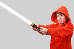 Boy with lightsaber Royalty Free Stock Image