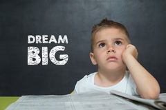 Boy like a Businessman with text DREAM BIG Stock Photography