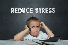 Boy like a Businessman with text REDUCE STRESS Royalty Free Stock Images