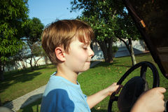 Boy likes to drive an electric car Stock Image