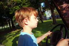 Boy likes to drive an electric car Stock Photography