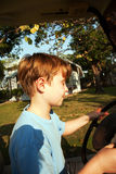 Boy likes to drive an electric car Royalty Free Stock Photos