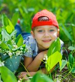 Boy with lilies of the valley Royalty Free Stock Photos