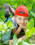 Boy with lilies of the valley Royalty Free Stock Images