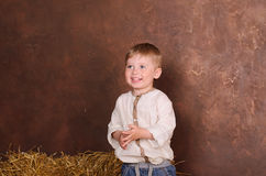 Boy in linen shirt indoors Stock Photography