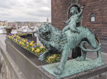 Boy on a lion from Stockholm Town Hall Royalty Free Stock Photography