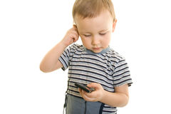 Boy  listen music. Boy holding music player and listen to music Royalty Free Stock Photos