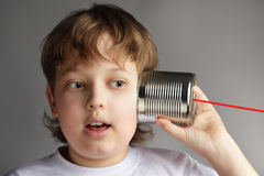 Boy listen tin can telephone Royalty Free Stock Photo