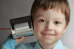 Boy listen tin can telephone Stock Image