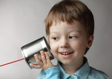 Boy listen tin can telephone Royalty Free Stock Photography