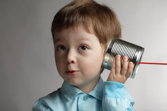 Boy listen tin can telephone Stock Photos