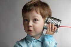Boy listen tin can telephone. Beauty boy listen tin can telephone Stock Photos