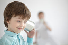 boy listen tin can telephone Royalty Free Stock Images