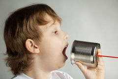 Boy listen tin can telephone Stock Photography