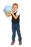 Boy listen to world globe Royalty Free Stock Images