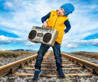 The boy listened to vintage tape recorder.Vintage style .Children`s fashion. royalty free stock images