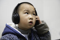 Boy listening Stock Images