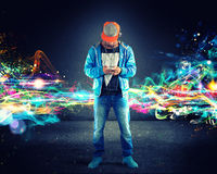 Boy listening hiphop music stock photo