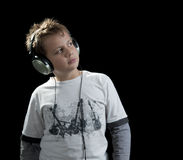 Boy listening music copy space Stock Image