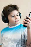 Boy listening  music with headphones Stock Photo