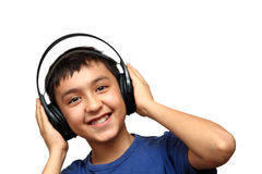 Boy listening music in headphones Royalty Free Stock Image