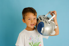 Boy listening at music from a stereo Royalty Free Stock Photo