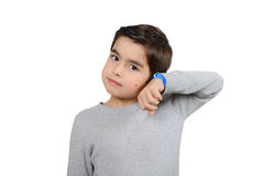Boy is listening to the clocks isolated on white Royalty Free Stock Photography