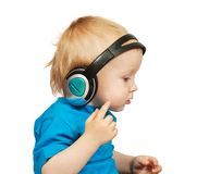 Boy listening to music Stock Image