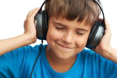 The boy is listening to music Stock Photo