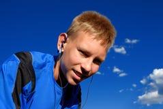 Boy listening to music Stock Photos