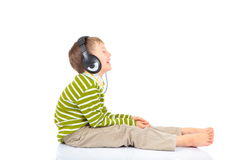 Boy listening to music royalty free stock images