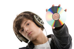 Boy listening to music displaying CD Stock Photo