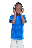 Boy listening to music with eyes closed Stock Photography
