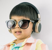 Boy is listening to Music on headphone Royalty Free Stock Photography