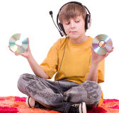 Boy listening to music in headphones Stock Image