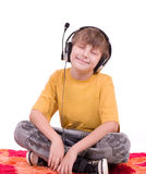 Boy listening to music in headphones Stock Images