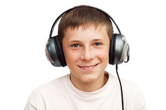 Boy is listening to music on headphones Royalty Free Stock Photography