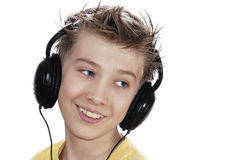 Boy listening to music with headphones. Royalty Free Stock Photo
