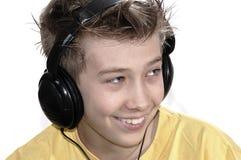 Boy listening to music with headphones. stock photo