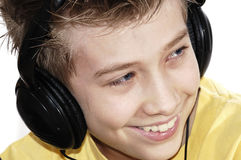 Boy listening to music with headphones. Royalty Free Stock Image