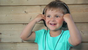 Boy listening to music stock video
