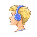Boy listening to music on headphones. Stock Photography