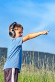 Boy listening to music on headphones in nature Stock Photos