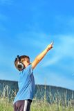 Boy listening to music on headphones in nature Stock Images