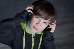 Boy listening to music on headphones Royalty Free Stock Images
