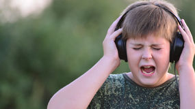 Boy listening to music with headphones Royalty Free Stock Images