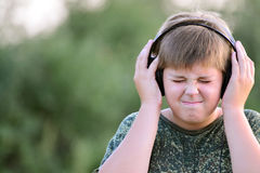 Boy listening to music with headphones Stock Photo