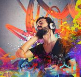 Boy listening to music Stock Images