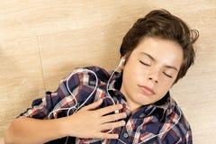 Boy listening to music Stock Image